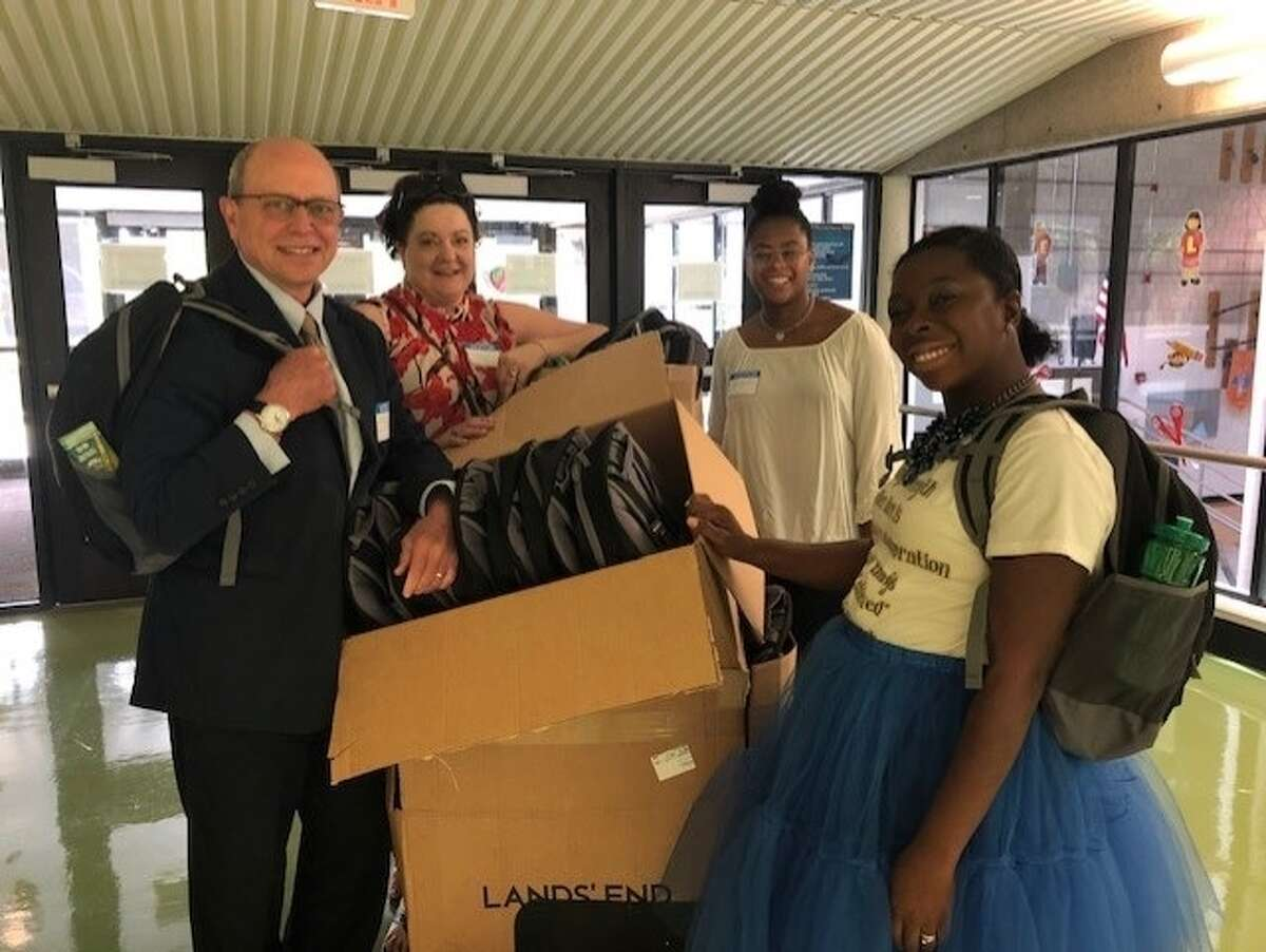 Albany law firm McNamee Lochner P.C., a 2020 Times Union Top Workplace, donates backpacks to area students.