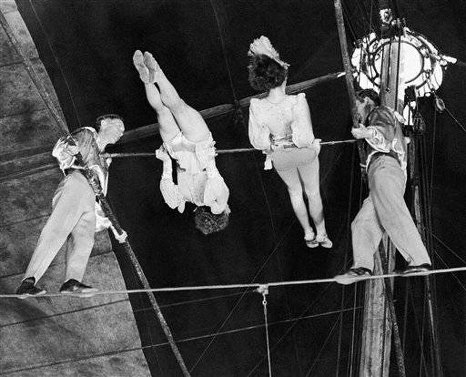 FILE- In this April 15, 1944 photo, members of The Flying Wallendas, famous high wire act with the Ringling Bros. and Barnum & Bailey's Circus, perform their death-defying double pinwheel in Madison Square Garden in New York. From left are Herman, Henrietta, Helen, and Karl Wallenda. On Friday, June 15, 2012, Nik Wallenda, a seventh generation Flying Wallenda, will attempt a high-wire crossing of the Niagra Falls gorge between the United States and Canada. The event will be covered on live television. (AP Photo)