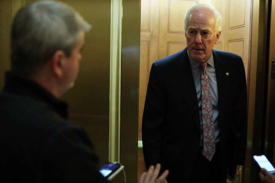 U.S. Sen. John Cornyn (R-TX) speaks to members of the press at the U.S. Capitol, March 23, in Washington, D.C. The Senate is working to finalize the coronavirus stimulus bill in response to the outbreak of COVID-19 pandemic. A reader says Sen. Cornyn's comments blaming China for the virus are reckless and irresponsible. Photo: Alex Wong /Getty Images / 2020 Getty Images