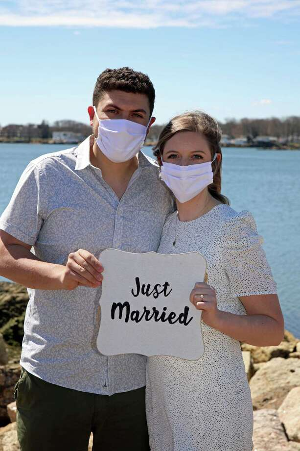 Chelsea Rubsam and Mike Kaplan tied the knot at Branford Point on April 4 in a very intimate ceremony, despite having to cancel their big wedding due to the coronavirus. Photo: Contributed Photo