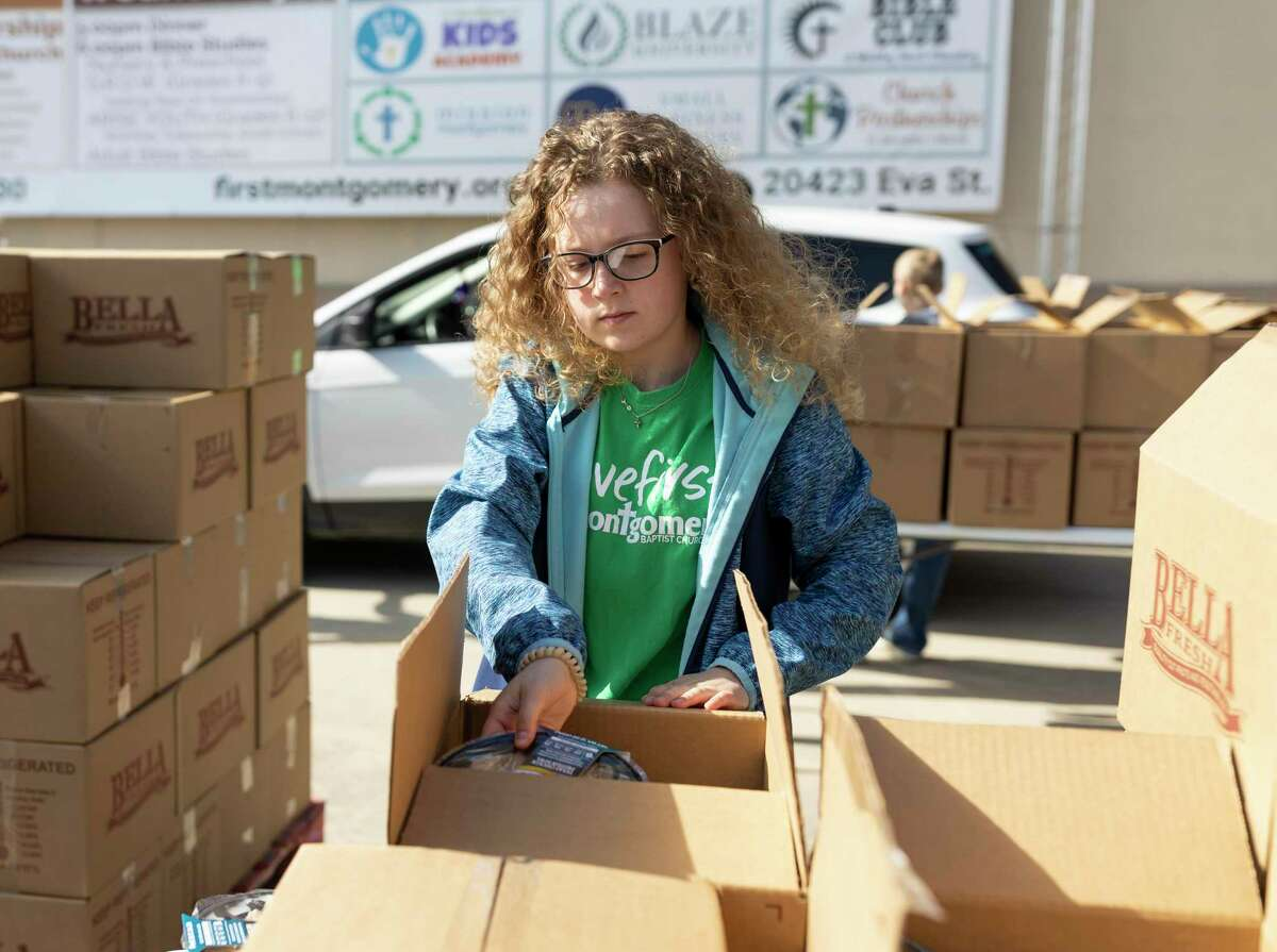 Karley Stanley, 14, assorts a boxed meal during a food drive at First Montgomery Baptist Church, Tuesday, April 14, 2020. Stanley began homeschooling before the COVID-19 pandemic.