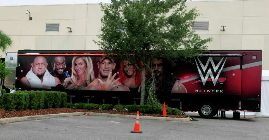 A trailer set up near a satellite truck to transmit wrestling broadcasts is parked outside the WWE Performance Center Tuesday, April 14, 2020, in Orlando, Fla. Florida's top emergency official last week amended Gov. Ron DeSantis' stay-at-home order to include employees at the professional sports and media production with a national audience, if the location is closed to the public. (AP Photo/John Raoux) Photo: John Raoux / Associated Press / Copyright 2020 The Associated Press. All rights reserved