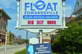 One of the Shop Small EdGlen signs in front of Karen Swanner's business, Float Edwardsville.