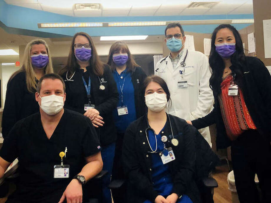 Healthcare professionals from HSHS Medical Group Priority Care in Springfield pose for a photo wearing their protective masks. The masks are among several precautions taken by HSHS Medical Group throughout the state to ensure the safety of their employees and patients during the COVID-19 pandemic. Photo: For The Intelligencer