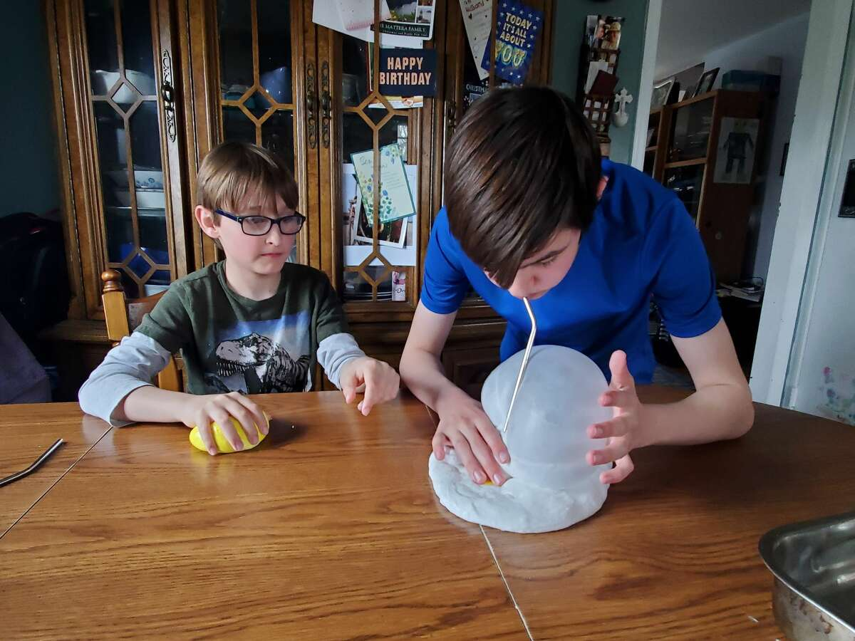 Brian and Tommy make bubbles in homemade slime in Bethel, CT.