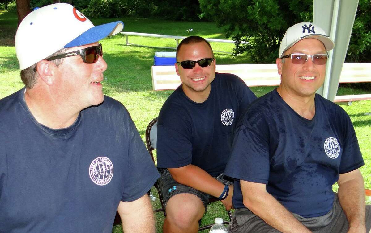 Police Detective Peter Bravo, Officer Don Matejek and Lt. Jeff Bloch played for the Police Department's team in the town's Wiffle Ball Tournament on Saturday.