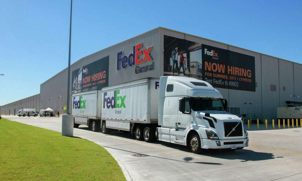 A FedEx truck leaving a FedEx Ground distribution hub in Houston.