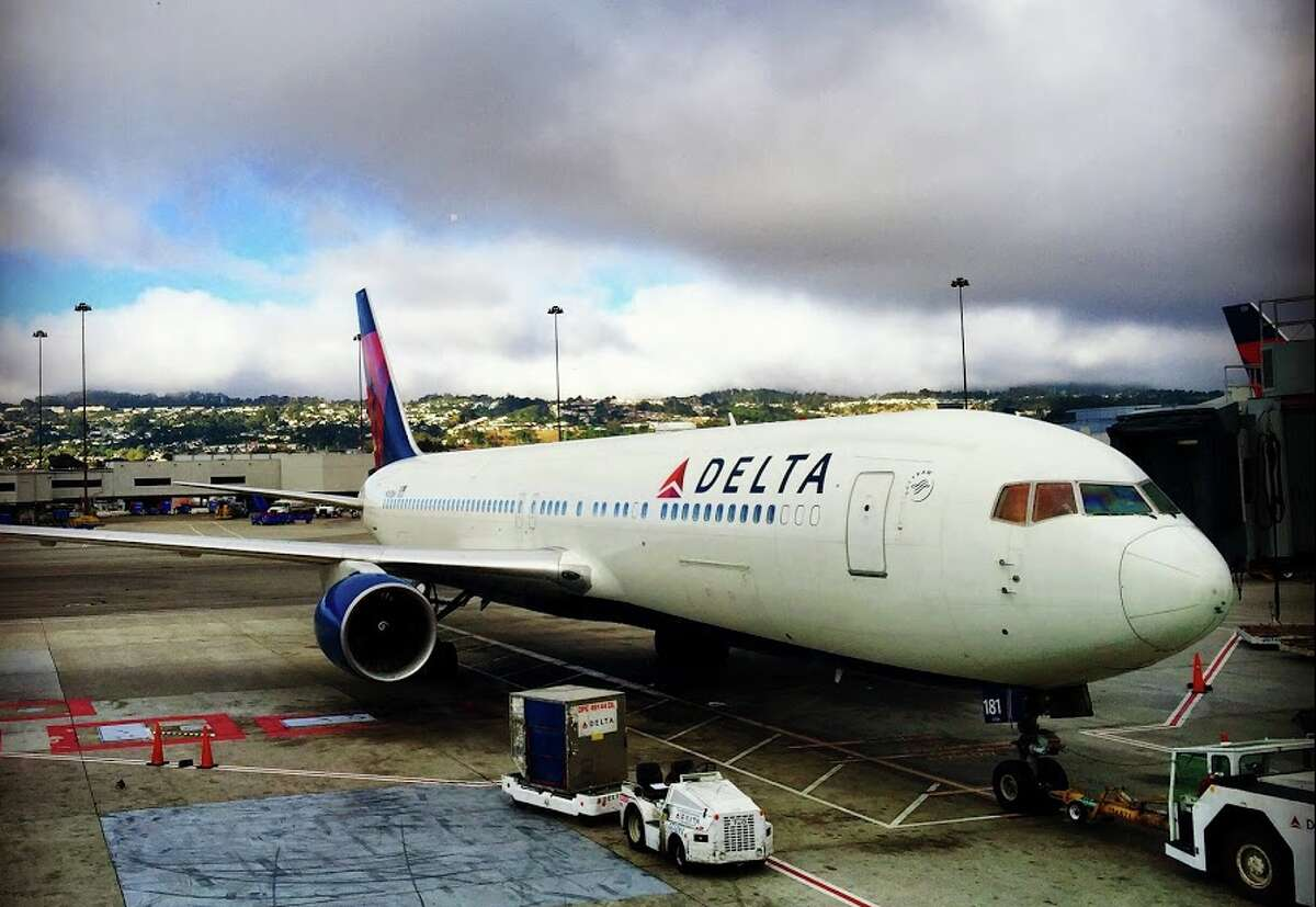 A Delta Airlines flight from Los Angeles to Atlanta was forced to ground early in Oklahoma City on Friday night after an unruly passenger attempted to open a plane door midflight.