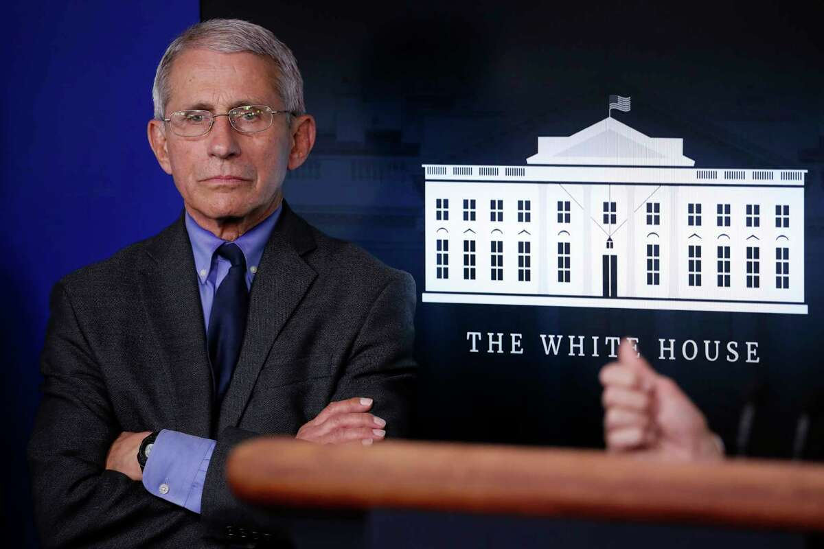 Dr. Anthony Fauci, director of the National Institute of Allergy and Infectious Diseases, listens as Vice President Mike Pence speaks about the coronavirus in the James Brady Press Briefing Room at the White House, Monday, April 13, 2020, in Washington. (AP Photo/Alex Brandon)