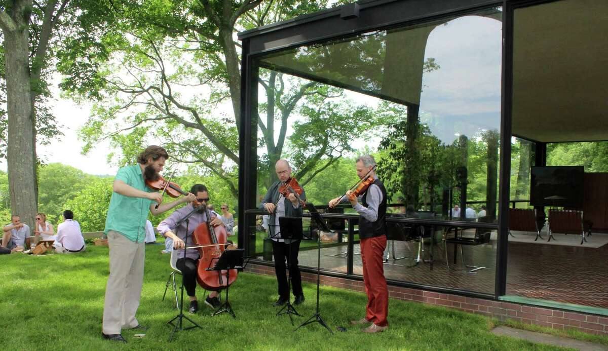 The musical quartet called the Brooklyn Rider performs the music of Composers Philip Glass, and John Cage at one of The Glass House's Summer Party in New Canaan. Social distancing is