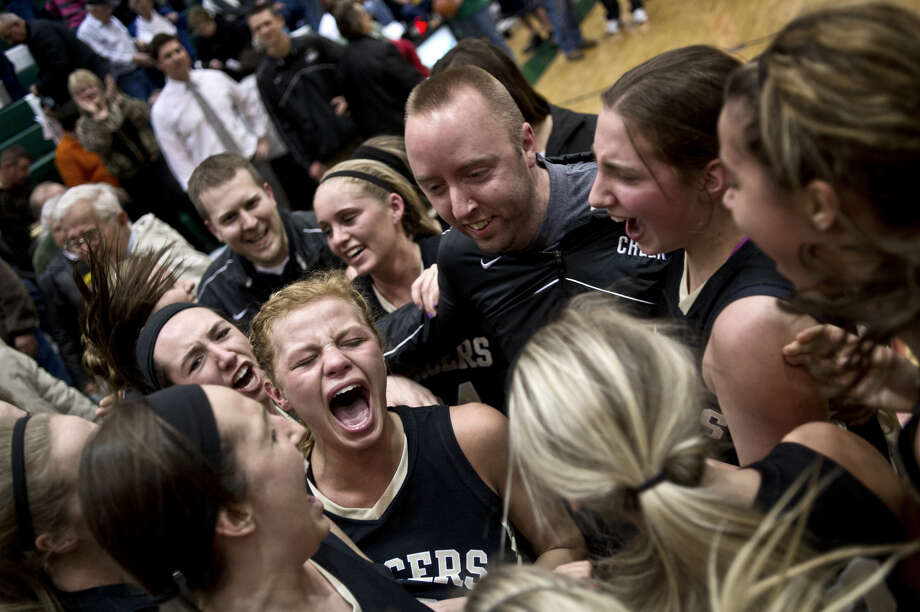 Bullock Creek's players and coaches celebrate the Lancers' dramatic win over Clare in a March 12, 2013 Class B quarterfinal. Photo: Daily News File Photo
