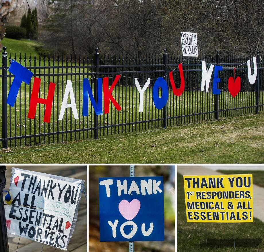 Signs thanking essential workers are displayed Wednesday, April 15, 2020 outside of homes along Sugnet Road, where hospital employees may see them on their way to work. (Katy Kildee/kkildee@mdn.net) Photo: (Katy Kildee/kkildee@mdn.net)