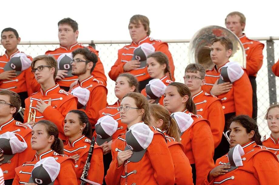 Orangefield observes the anthem before taking the field against Monsignor Kelly High School Friday night. Photo taken Friday, September 29, 2017 Kim Brent/The Enterprise Photo: Kim Brent / Beaumont Enterprise / BEN