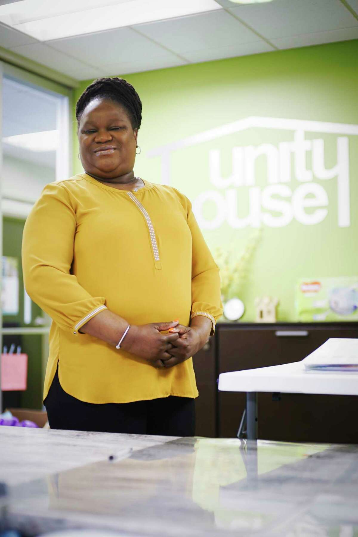 Pauline Glenn, a receptionist at Unity House poses for a photo at the reception desk on Wednesday, April 15, 2020, in Troy, N.Y. (Paul Buckowski/Times Union)