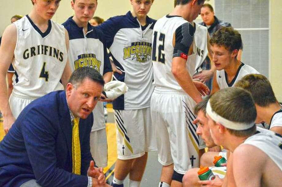 Father McGivney coach Rich Beyers talks to his team during a timeout during the 2018-19 regular season. Beyers was relieved of his coaching duties Monday.