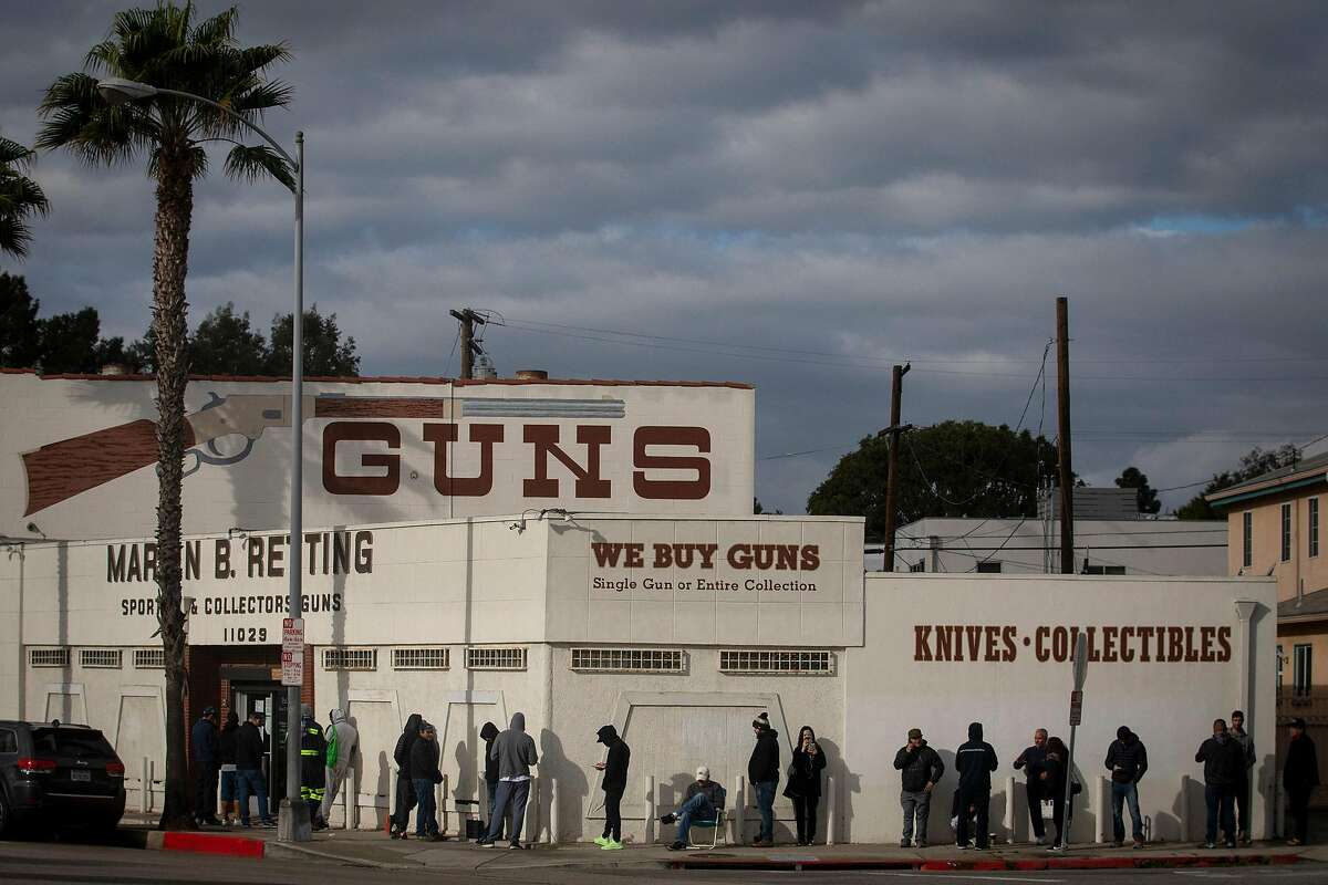 A line at the Martin B. Retting gun store in Culver City, Calif., on Sunday, March 15, 2020 extends out the door and around the corner. (Francine Orr/ Los Angeles Times/TNS)