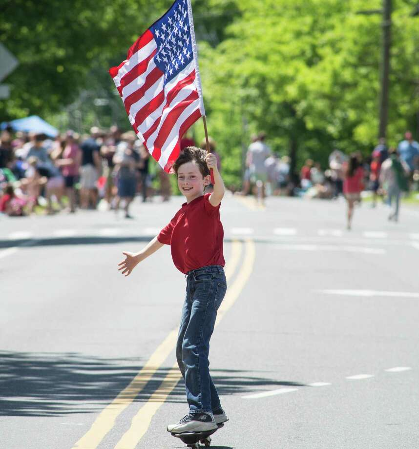 Damien Grimm, 11, of Ridgefield skated on Main Street before the Memorial Day Parade on Monday, May 28, 2019 in Ridgefield, Conn. Two thousand marchers representing more than 75 organizations marched on Memorial Day, The parade started at Jesse Lee Church and ended in the park. Photo: Bryan Haeffele / Hearst Connecticut Media / Connecticut Post