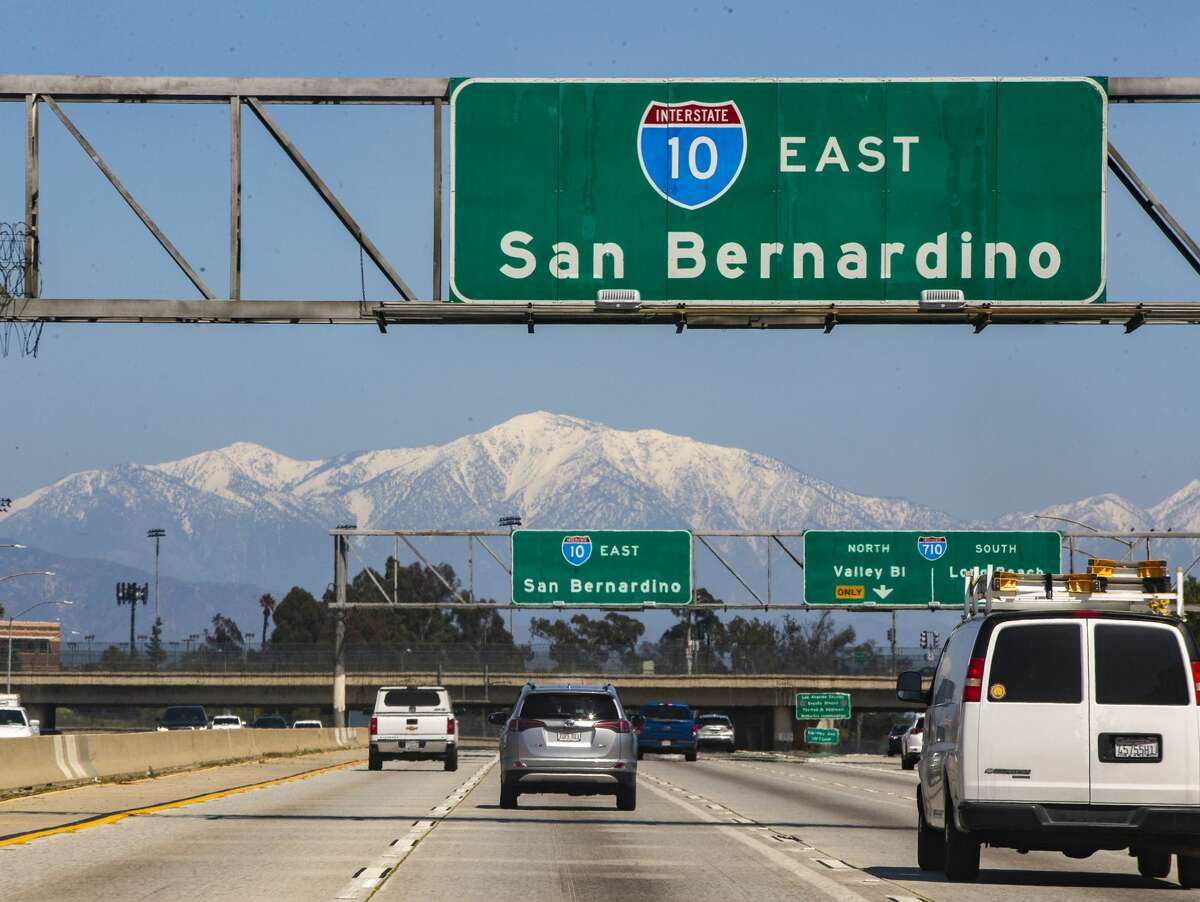 The San Gabriel Mountains are seen from the Interstate 10 in East Los Angeles, Monday, March 30, 2020. Excellent air quality has resulted from business closures during the coronavirus pandemic and recent rain. The area's famous freeway have been nearly empty, but experts say the lack of cars is contributing only a small amount to the clear skies.