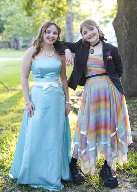 Abigail Plunkett, left, a home-schooled senior, says she'll wear pearls with her dress when she hosts a virtual prom open to all students. She poses with her sister Izzy, a freshman, at their Houston home. Photo: Elizabeth Conley/Staff Photographer / ? 2020 Houston Chronicle