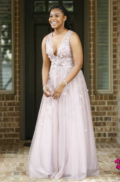 Ciarra Thomas may get to wear her dream dress if Elkins High School reschedules its prom – or if her date's goes on as scheduled. Photo: Elizabeth Conley/Staff Photographer / ? 2020 Houston Chronicle