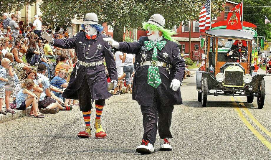 Catherine Avalone - The Middletown Press ¬ Members of the Funsters Sphinx Shriners of Newington, Fizz-Bo and Bubbles march in the the 2008 East Hampton Old Home Days Parade. ¬ Photo: Journal Register Co.