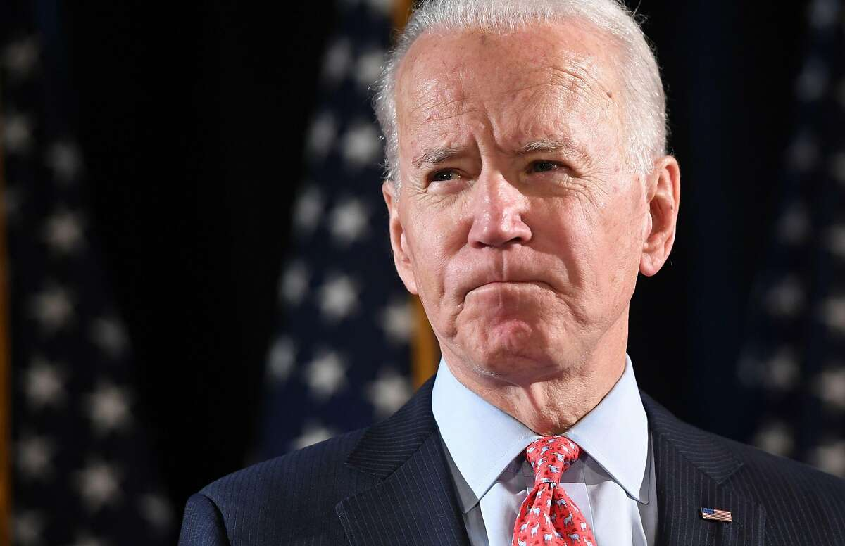 (FILES) In this file photo taken on March 12, 2020 former US Vice President and Democratic presidential hopeful Joe Biden speaks about COVID-19, known as the Coronavirus, during a press event in Wilmington, Delaware. - Barack Obama celebrated the kickoff of his