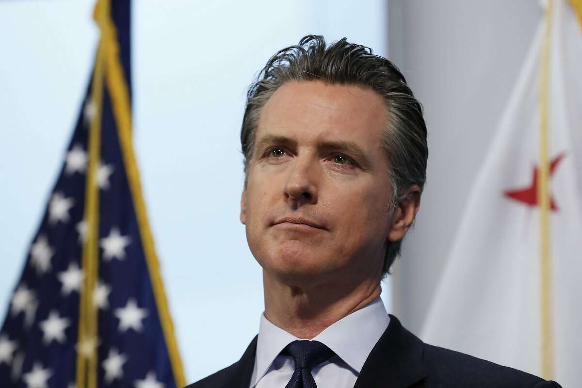 Gov. Gavin Newsom updates the state's response to the coronavirus during a news conference at the Governor's Office of Emergency Services in Rancho Cordova, Calif., Monday, March 30, 2020. Newsom announced the state is enlisting retired doctors and medical and nursing students to help treat an anticipated surge of coronavirus patients. (AP Photo/Rich Pedroncelli, Pool)