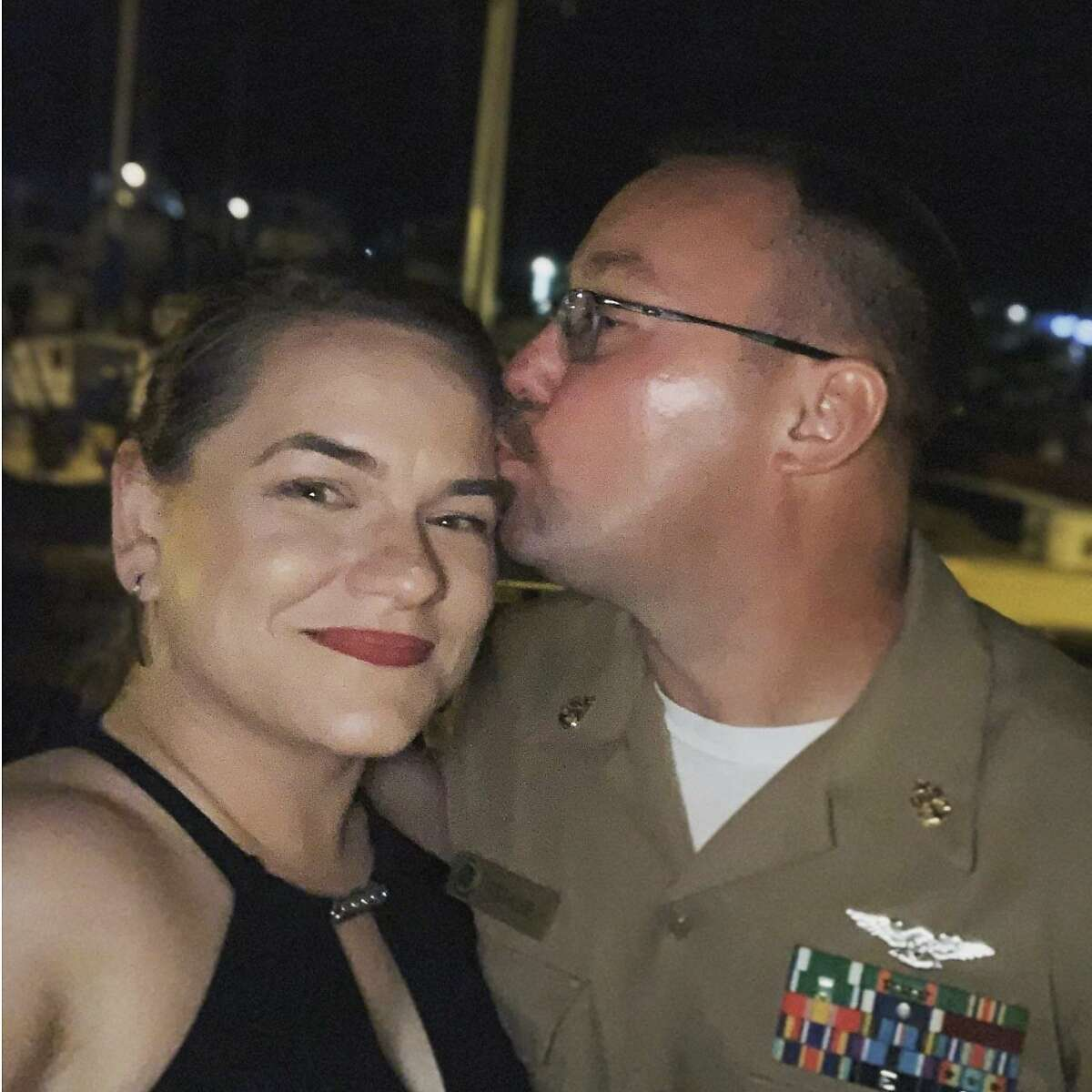 Navy chief petty officer Charles Robert Thacker Jr., is seen with his wife Symantha Thacker in a photograph posted to his Facebook account in October of 2019. Thacker was among the military personnel aboard the USS Roosevelt to be stricken with Covid-19 and he was the first member of the U.S. military to die from the disease. He was found unresponsive in his room aboard the ship and taken to a hospital on the island of Guam, where he and other infected members of the battleship had been taken for treatment.