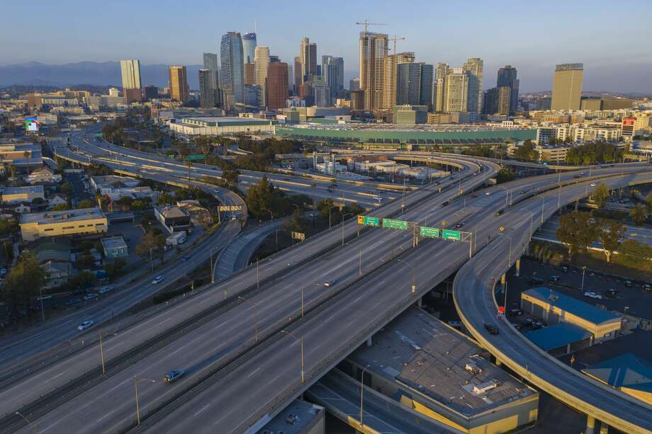 FILE: Extremely light traffic for the region is seen in an aerial view of the 10 and 110 freeway interchange on April 1, 2020 in Los Angeles. Photo: David McNew/Getty Images / 2020 David McNew