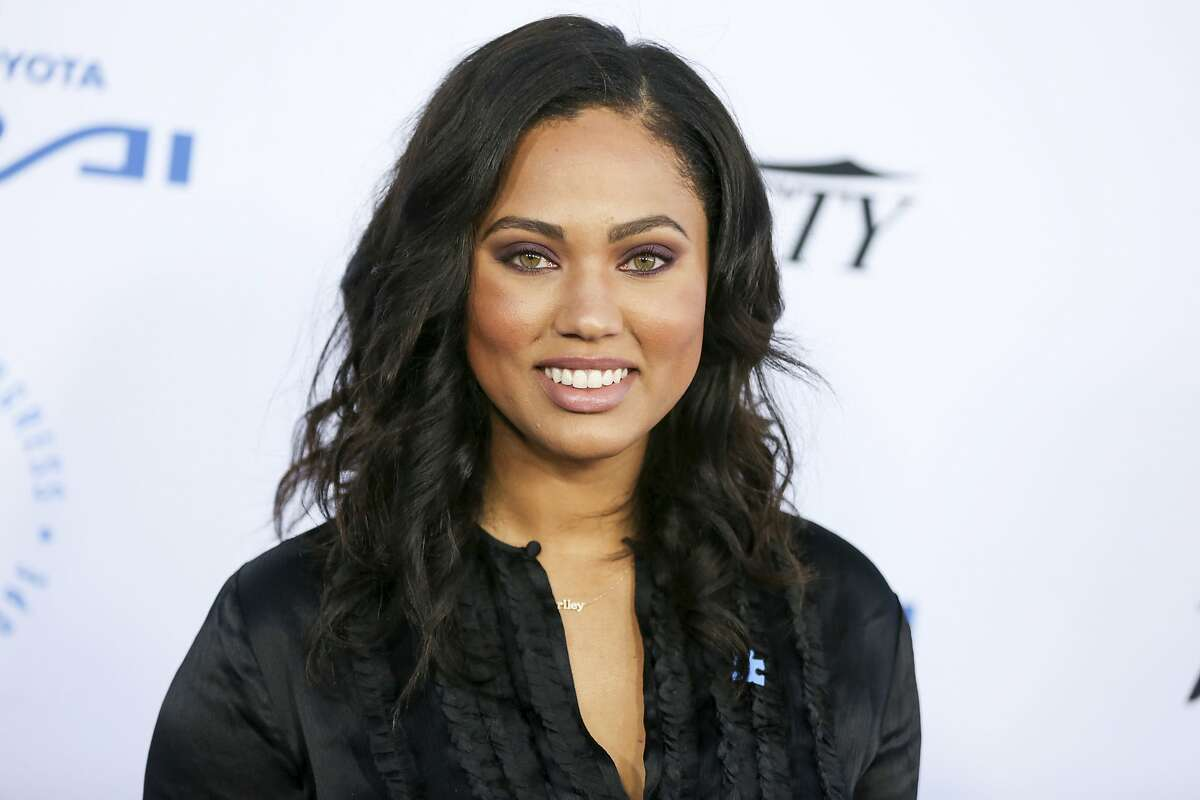 FILE - In this Oct. 8, 2015 file photo, Ayesha Curry arrives at the Autism Speaks to LA Celebrity Chef Gala in Santa Monica, Calif. A celebrity branding company is seeking at least $10 million in a breach-of-contract lawsuit against Curry, food and lifestyle personality and wife of NBA star Stephen Curry. (Photo by Rich Fury/Invision/AP, File)
