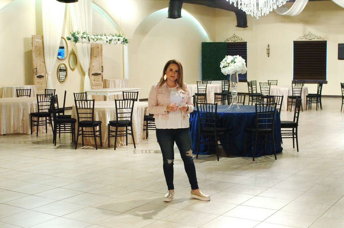 Letti Sanchez, owner of The Gates on Main Street in La Porte event venue, spends much of her time on the phone as clients reschedule because of the novel coronavirus pandemic.