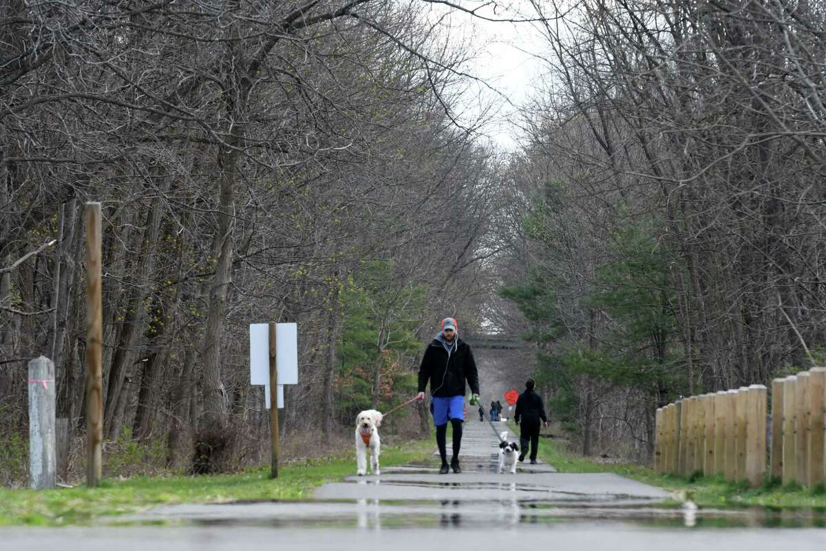 Exercise seekers use the Albany County Helderberg-Hudson Rail Trail on Wednesday, April 15, 2020, in Bethlehem, N.Y. Police said someone was found seemingly unconscious on the rail trail in April 2021. When he awoke to police helping them, he had a Taser. (Will Waldron/Times Union)