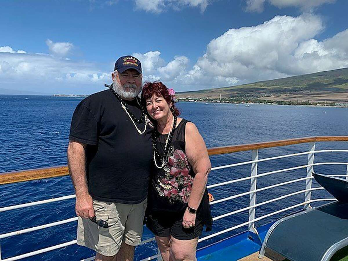 Michael and Susan Dorety are pictured on a Princess cruise, which ended in tragedy when they both contracted coronavirus. Michael passed away from the COVID-19 disease and his wife is now suing the cruise line.