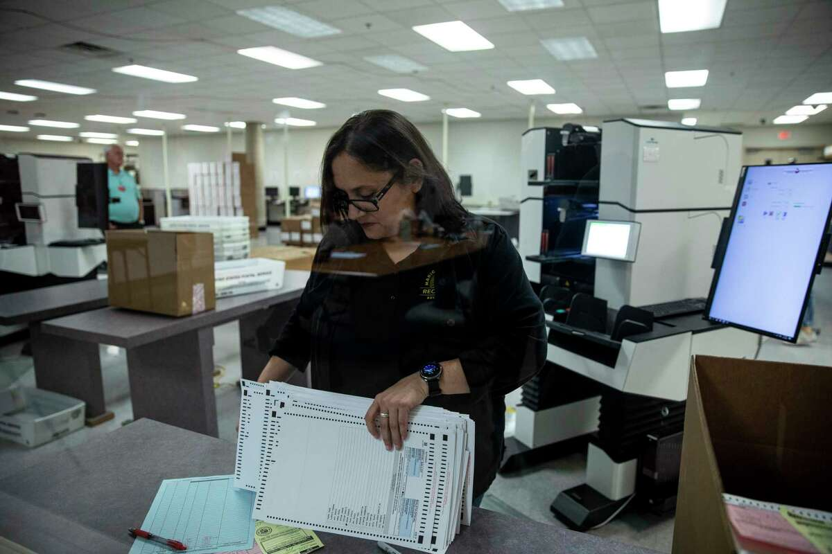 FILE - Mail-in ballots are counted at the Maricopa County recorder?•s office in Phoenix, March 17, 2020. Election experts, voting rights advocates and a chorus of Democrats are urging states to switch as much as is possible to voting by mail for the November election. (Adriana Zehbrauskas/The New York Times)