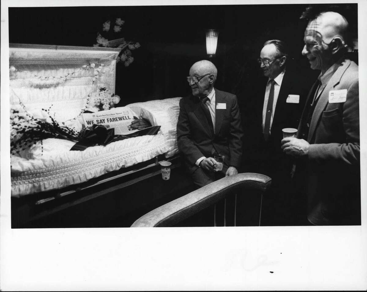 Orange and Chapel Streets, Albany, New York - Former City Editor Duane LaFleche, Former Columnist Arvis Chalmers, and Former Reporter Bill Ingram gather around a coffin holding the final edition of the Knickerbocker News at wake. April 16, 1988 (Tom LaPoint/Times Union Archive)