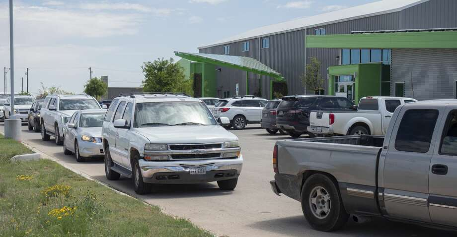 Midlanders line up for the drive-thru pantry Wednesday at the West Texas Food Bank. Local attorneys have offered a $100,000 challenge match for the nonprofit. Photo: Tim Fischer/Midland Reporter-Telegram