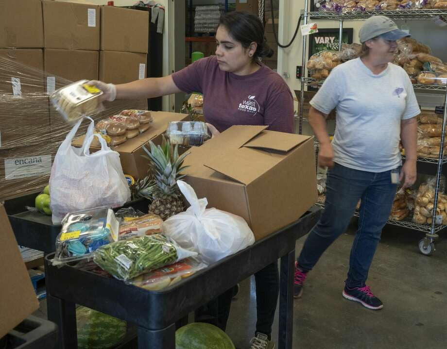 Anabel Gutierrez and Patti Edgar organize food bundles 04/15/2020 at the West Texas Food Bank in Midland for individuals and families to pick-up. Tim Fischer/Reporter-Telegram Photo: Tim Fischer/Midland Reporter-Telegram