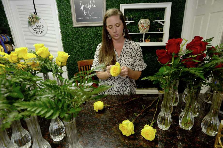 Sara Brady, owner of Sparkle & Co., a small florist in Nederland, makes arrangements of yellow and red roses, which will be distributed to senior citizens to brighten their time isolated amid stay at home orders and quarantine amid the growing COVID-19 response throughout Southeast Texas and the world at large. Brady is working with First Baptist Church in Nederland, who will make the deliveries to their area seniors isolated at home or in nursing homes. It is the second round of sponsoring a senior to recieve flower arrangements, and a program she hopes to continue throughout the course of the virus outbreak response. Photo taken Friday, April 3, 2020 Kim Brent/The Enterprise Photo: Kim Brent / The Enterprise / BEN