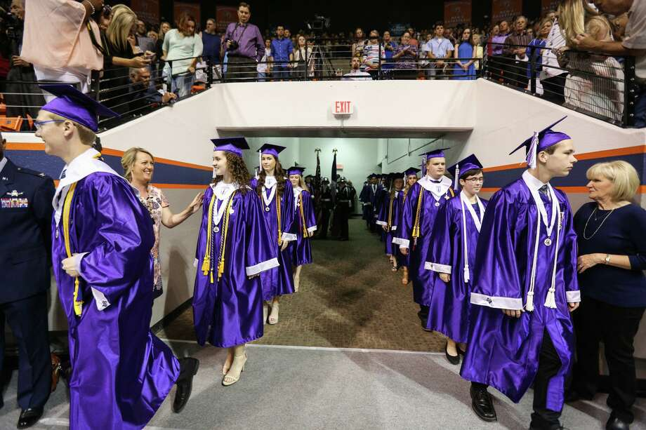 Graduates enter the Bernard G. Johnson Coliseum during the Willis High School commencement ceremony on Friday, May 26, 2017, at Sam Houston State University. Photo: Michael Minasi, Staff Photographer / Houston Chronicle / © 2017 Houston Chronicle