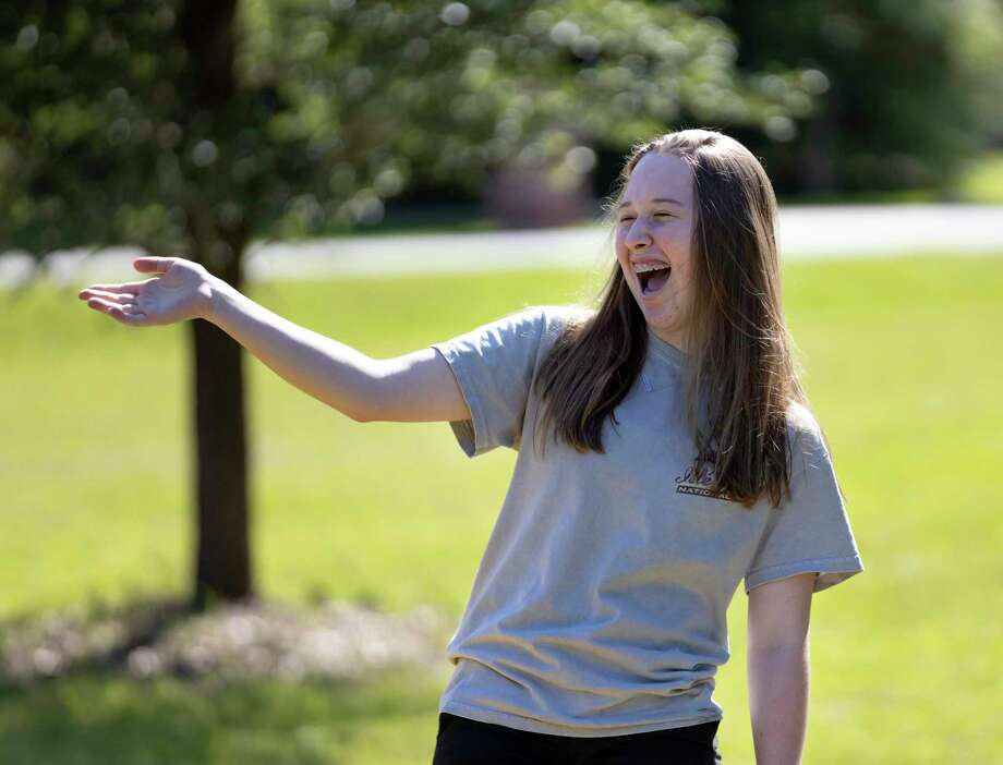 Audrey Hammons, 14, reacts after she is surprised by family, friends and teammates who shouted happy birthday wishes to her in a drive-by style parade in Crown Oaks in Montgomery, Tuesday, April 14, 2020. Tina Hammons, Audrey's mother, was inspired by others who have held surprise birthday drive-by celebrations. Photo: Gustavo Huerta, Houston Chronicle / Staff Photographer / Houston Chronicle © 2020