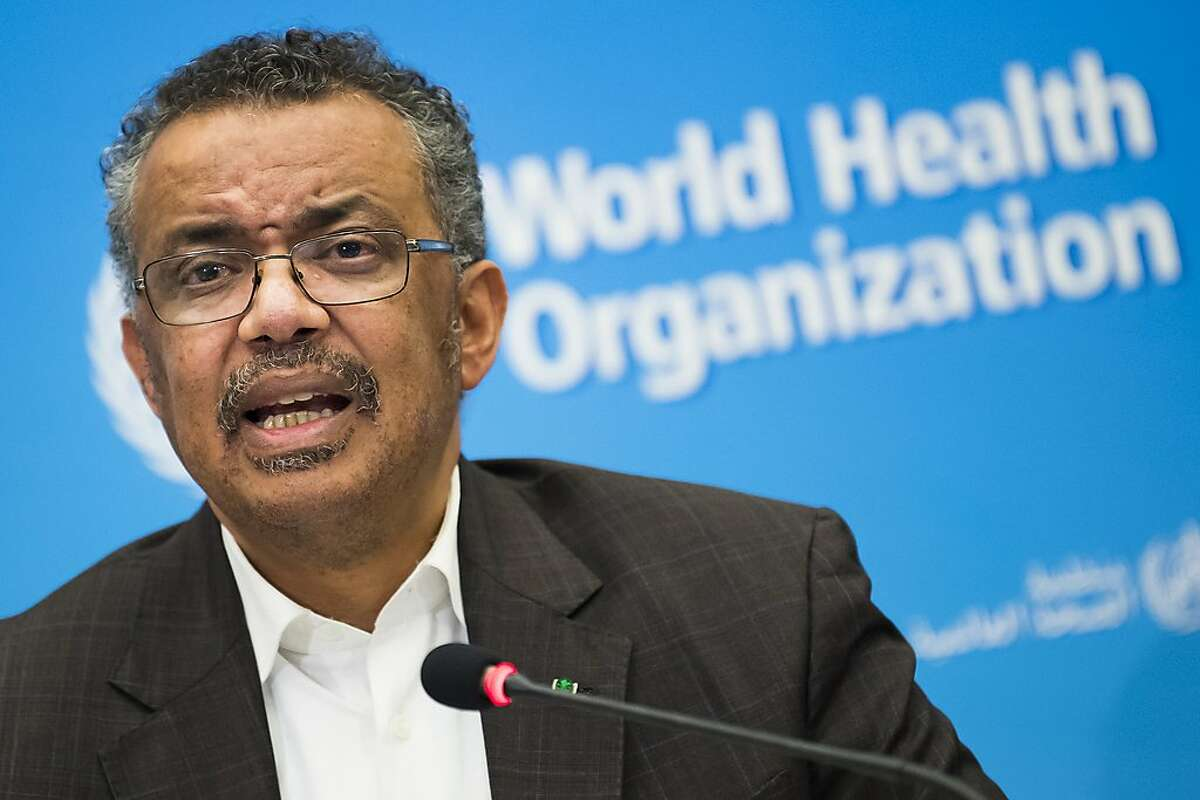 """Tedros Adhanom Ghebreyesus, Director General of the World Health Organization (WHO), talks to the media at the World Health Organization headquarters in Geneva, Switzerland, Thursday, Jan. 30, 2020. The World Health Organization declared the outbreak of a new deadly virus which originated from China a """"global health emergency."""" China, where the coronavirus emerged, has reported 170 deaths and at least 7,800 infections from the infection. (Jean-Christophe Bott/Keystone via AP)"""