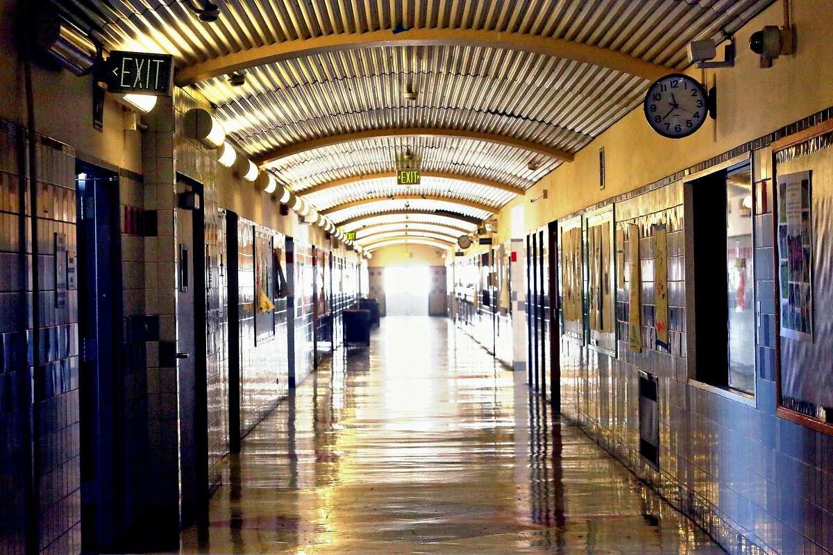 An empty corridor is seen at Thurgood Marshall Academic High School on Thursday, March 12, 2020 in San Francisco, Calif.
