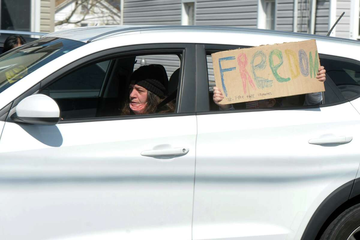 Several dozen people gathered and drove their cars in a caravan around the Bridgeport Correctional Center, in Bridgeport, Conn. April 15, 2020. The protest was held to raise awareness to the plight of inmates currently incarcerated in state prisons during the COVID-19 crisis.