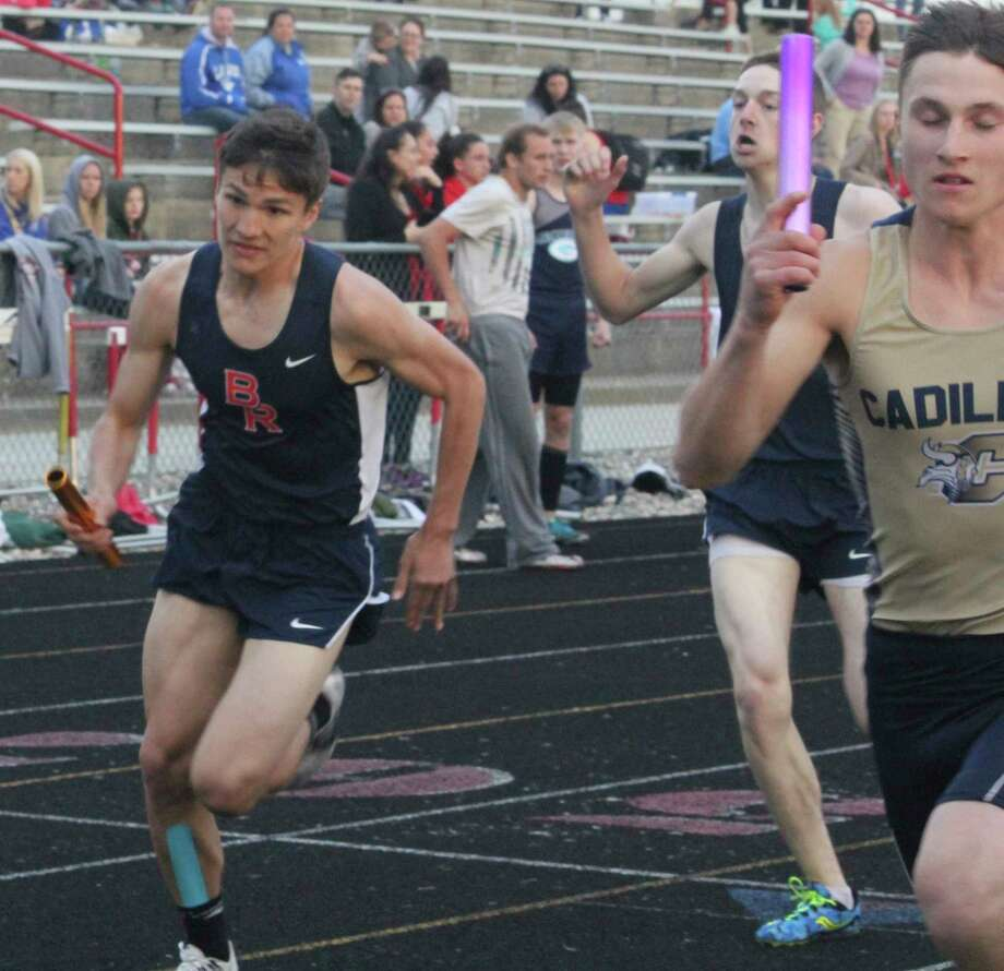 Big Rapids' Kaden Torres (left) turns on the speed during a relay race at Chippewa Hills last season. (Pioneer file photo)