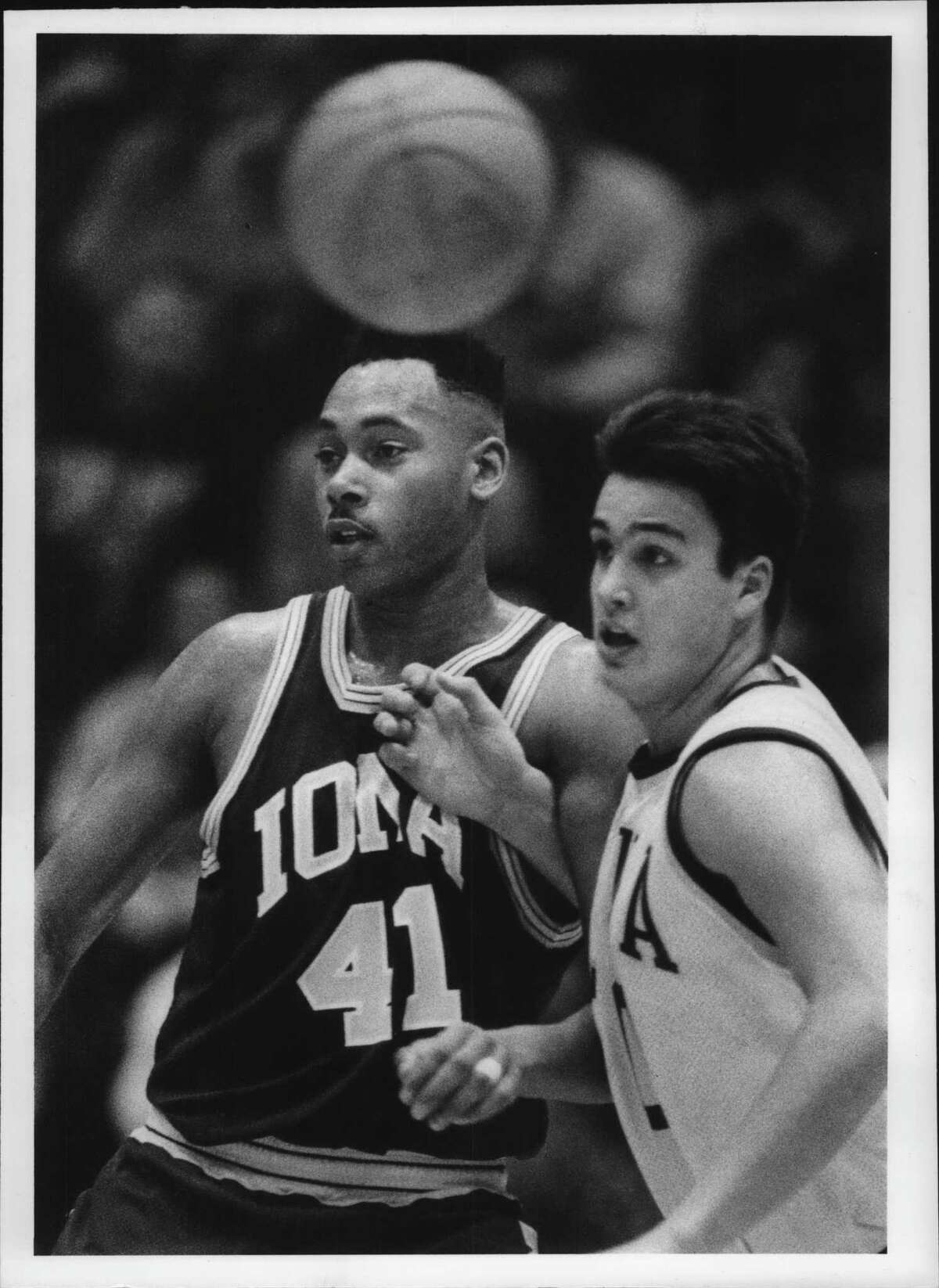 Iona's #41 Harry Hart and Siena's #50 Matt Gras defend each other as the ball passes above their heads during Saturday nights game at Siena College, New York. February 13, 1993. Gras died from COVID-19 in 2020.