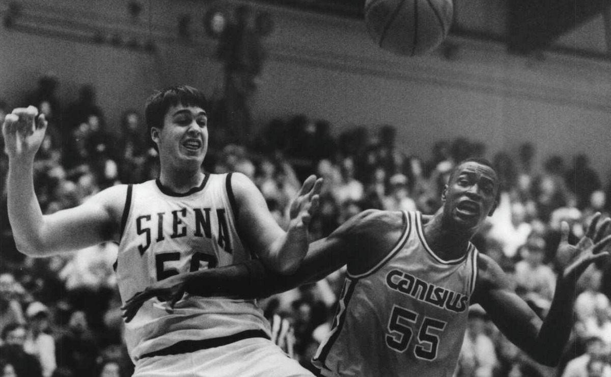 Siena basketball player #50 Matt Gras and Canisius #55 Michael Meeks battle for rebound during their game. January 05, 1994 (Luanne Ferris/Times Union Archive)