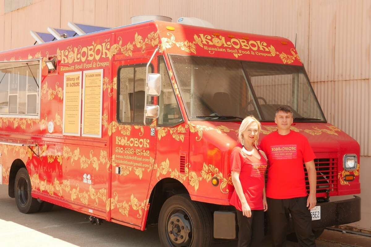 Ellen Doren and her husband Bulat Nasybulin in front of Kolobok Russian Soul Food.