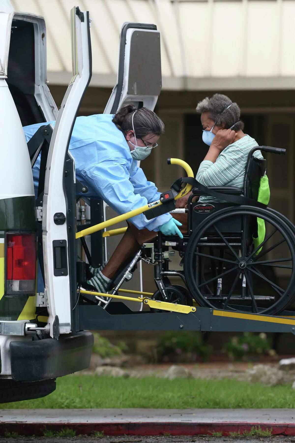 A resident is taken out of the Southeast Nursing and Rehabilitation Center by a private ambulance on April 3, 2020. Seventeen residents of the nursing home have died after contracting the coronavirus.