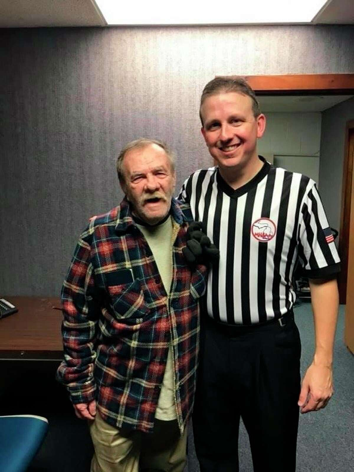 Baldwin's Matt Miller (right) is pictured with Terry Gibson, who got him into officiating, and now lives in Belding. (Courtesy photo)