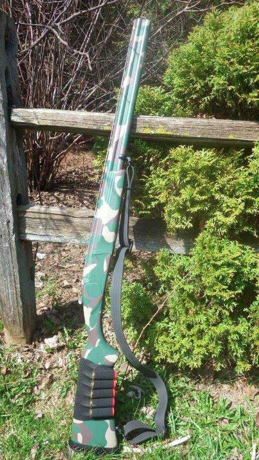 """The writer'sfavorite turkey shotgun is a custom camo-painted Remington """"Spartan""""over-and-under 12-gauge with full chokes and offers a quick follow-up shot whenrequired. (Tom Lounsbury/Hearst Michigan)"""
